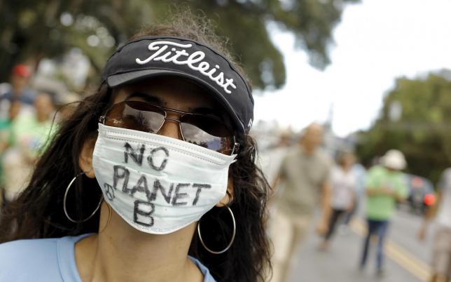 An activist takes part in a rally held the day before the start of the Paris Climate Change Conference (COP21), in San Jose, Costa Rica, November 29, 2015. REUTERS/Juan Carlos Ulate