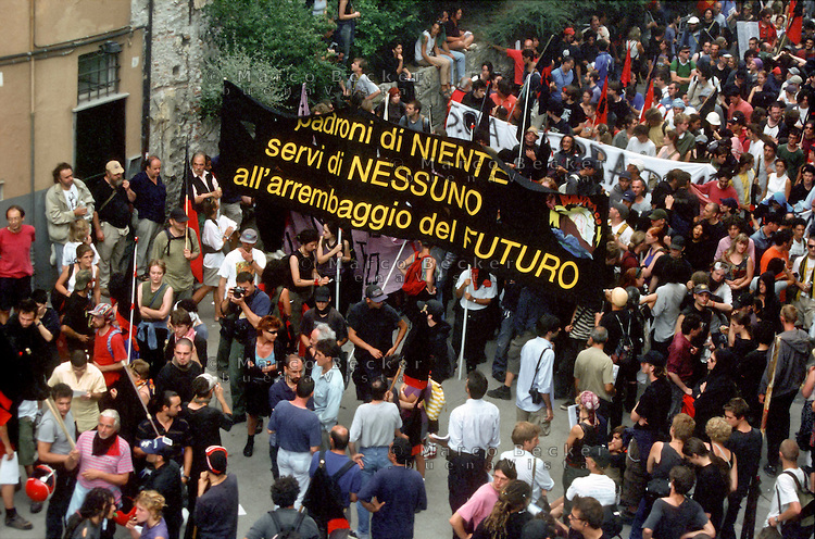 "genova luglio 2001, proteste contro il g8 --- genoa july 2001, protests against g8 summit ""owner of nothing, nobody's servants, rushing to the future"""