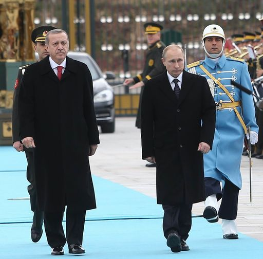 Russian President Vladimir Putin (R) and his Turkish counterpart Recep Tayyip Erdogan review an honor guard on December 1, 2014 during a welcoming ceremony at the new presidential palace outside Ankara. Putin is on a one-day state visit to Turkey.                        AFP PHOTO/ADEM ALTAN